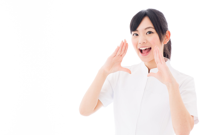 attractive asian nurse yelling white background